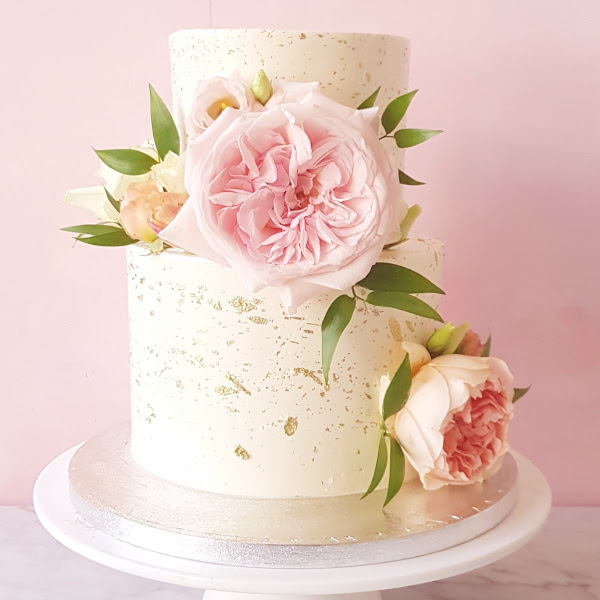 Gold splattered cake with flowers – from £70